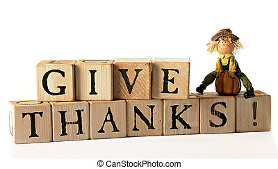 Give Thanks - Rustic alphabet blocks arranged to spell out,...