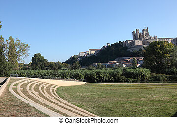 Old amphitheater and the cathedral in Beziers, France