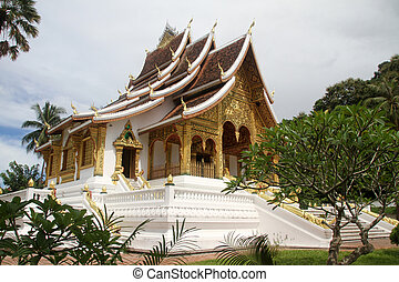 White buddhist temple near royal palace in Luang Prabang,...