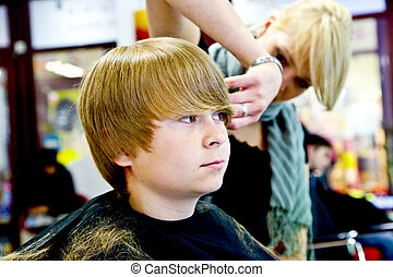 young boy at the hairdresser - smiling young boy at the...