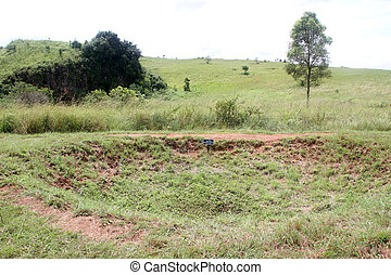 Bomb crater - American bomb crater on the Plain of jars,...