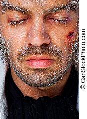 Male frozen face - Close-up of man with closed eyes and...