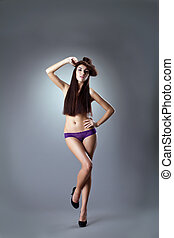 woman with long hairs stand in purple panties