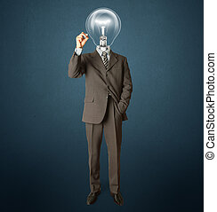 businessman with lamp-head and marker writting something on...