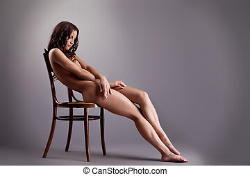 Perfect naked girl lay on white