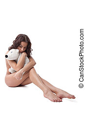 Beauty naked woman sit with plush bear isolated