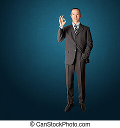 full length asian business male in suit shows OK