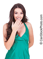 excited young woman with her hand over her mouth, over white...