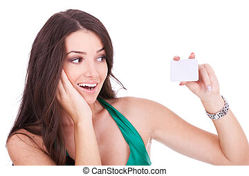 woman looking at her bussiness card - Portrait of an excited...