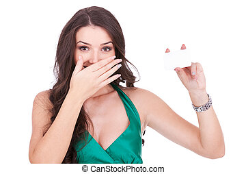 surprised young woman  with a card
