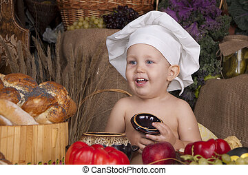 Cute boy cooking in chef's hat