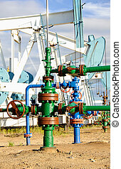 Oil well and pump jack. - Extraction of oil. Wellhead with...