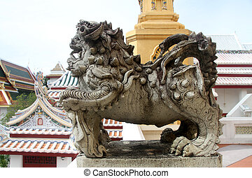 Stone lion statue in wat Bowonniwet in Bangkok, Thailand