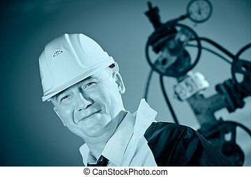 Worker. - Worker in uniform and helmet on of background the...