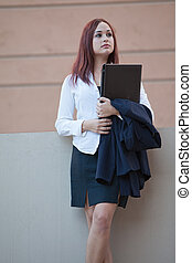Pretty twenties native american businesswoman working with laptop