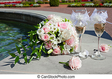 wedding bouquet of tbride and glasses of champagne -...