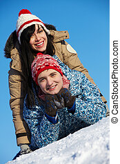 Cheerful dates - Portrait of happy couple in warm clothes...