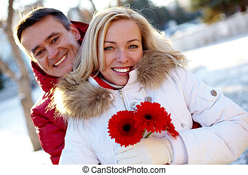 Cute couple - Photo of happy man and woman outdoor in winter