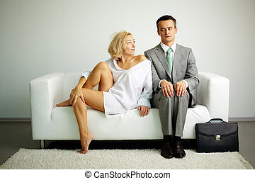 Misunderstanding - Photo of serious man sitting on sofa with...