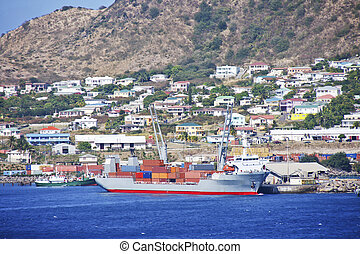 Freighter at Loading Docks on Tropical Coast - A full...