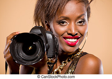 Model with Camera - African american model holding DSLR...