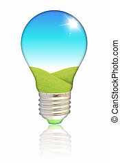 Natural energy concept. Light bulb with summer meadow