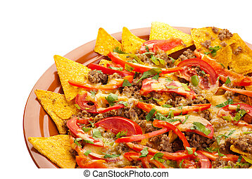 spicy nachos with pork, tomato and pepper - Plate of freshly...