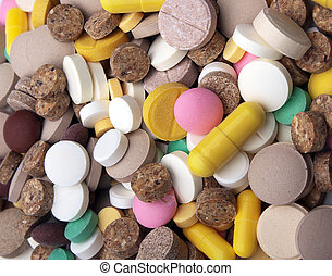 Heap of colored tablets - the medical background - heap of...