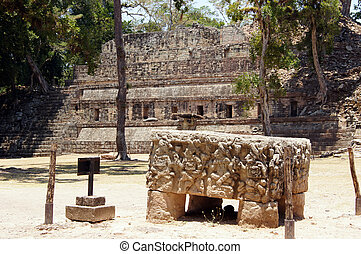 Copan - Stone altar and square with pyramid in Copan,...