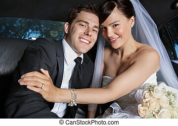 Happy Newlywed Couple - Portrait of newlywed couple smiling...