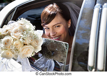 Happy Bride With Flower Bouquet - Happy bride sitting in...