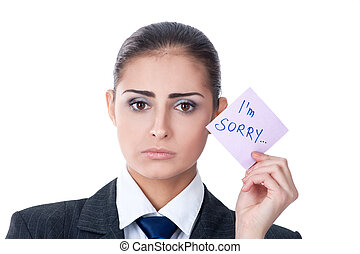 """woman holding a note saying """"sorry"""" - sad young woman..."""