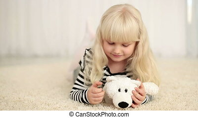 Happy girl with teddy bear looking