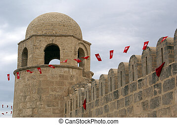 Sousse - Fortress and red flags in medina of Sousse, Tunisia...