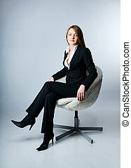 Female manager pauses in the work of sitting in a chair