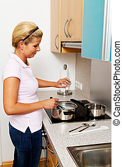 woman in the kitchen when cooking