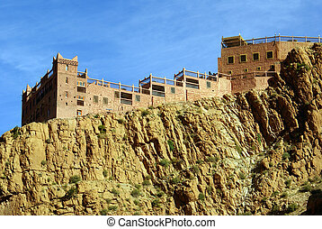 Casbah on the rock in mountain, Morocco