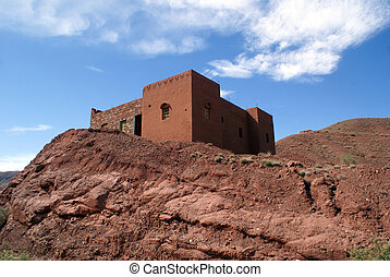 Casbah on the rock in mountain area, Morocco...