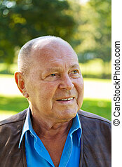 portrait of an elderly man senior portrait outdoors