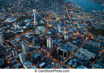 Space Needle and Belltown at Dusk - Aerial view of lights on...