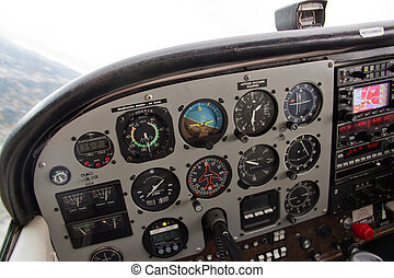 Pilots View of Complex Instrument Panel of Small Airplane -...