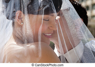 Husband Kissing His Wife - Bridegroom kissing his bride on...