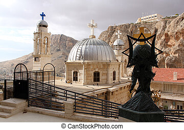 Convent - Statue and towers in convent Saint Takla in...
