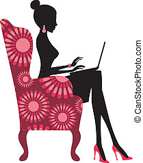 Fashion Blogger - Young fashionable woman working on laptop...