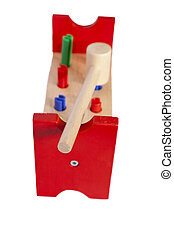 Wooden toy for kids with hammer isolated on white