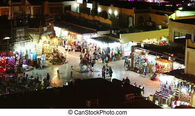 Shopping center at night - Time lapse of crowds of people on...