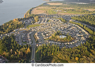 Suburban Neighborhood on Top of a Hill - Aerial view of tree...