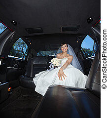 Bride Sitting in Limousine - Attractive bride sitting in...