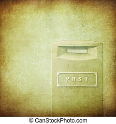 yellow mail-box over grunge background