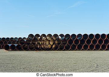 Pipes - Stack of big plastic pipes ready at the construction...